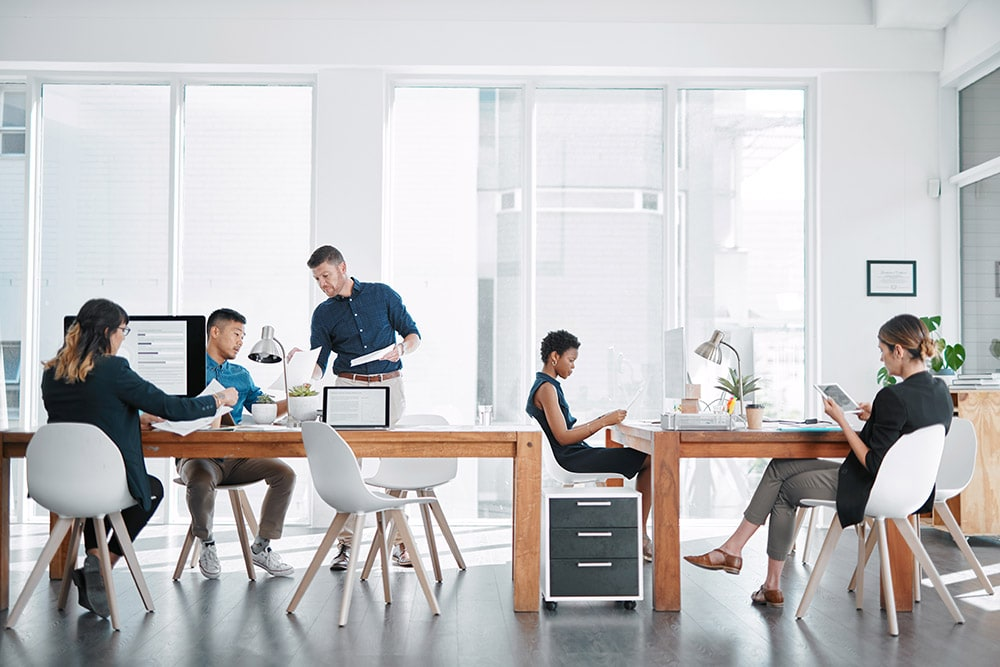businesspeople working together in a modern office