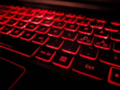 Black laptop keyboard with red light