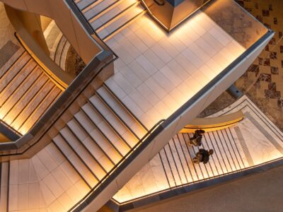 Two people walking down a matrix of stairs