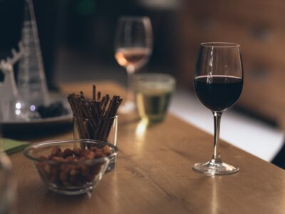 Red wine and snacks on a table