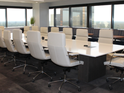 White boardroom table and chairs